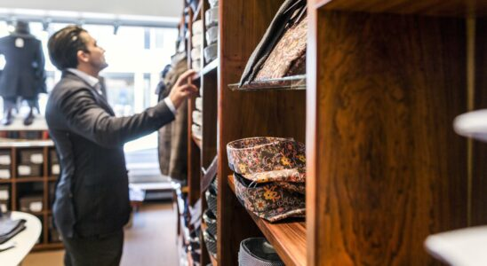 Man looking at clothes in clothing store